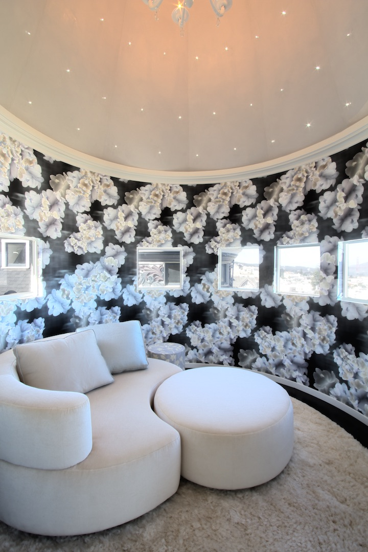 Trove wall covering in a circular room