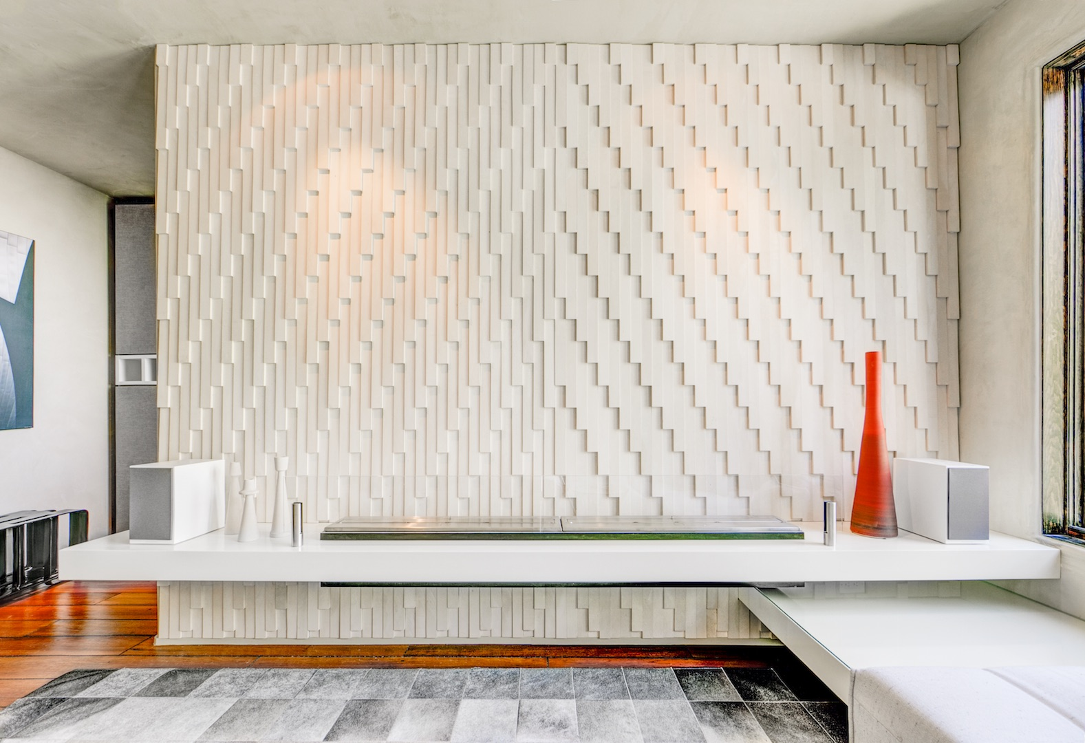 Tile wall pattern over fireplace seating area